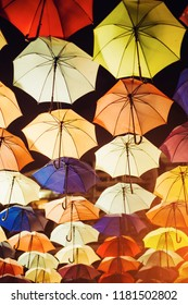 many colorful umbrellas protecting the sunlight at outdoor. night photography