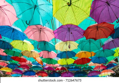 many colorful umbrellas protecting the sunlight at outdoor