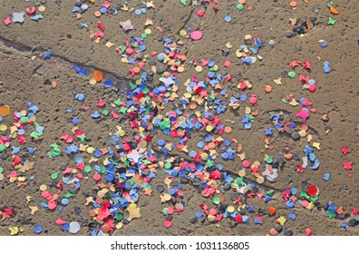 many coloured confetti on the floor after the party