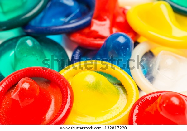 Many colourful condoms in a pile