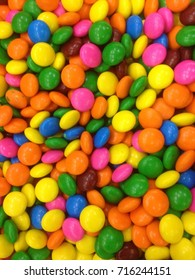 Many colourfull chocolate candy dots for the background
