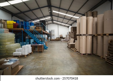 Many containers and plastic packaging in a large warehouse