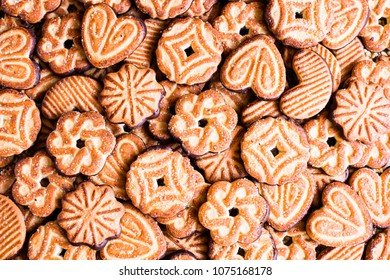 Many cookies in assortment. Collection of cookies dipped in chocolate sauce. Glazed food. Food background with sweet cookies in different shape. Full frame image. Macro food photography. Texture.