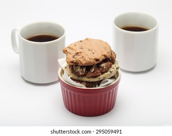 The many cookies inside ceramic cup cake and coffee cup set for relax and break from meeting