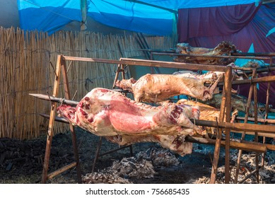 Many Cooking Traditional Turkish roasting lamb barbecues.Roasted meat over an open fire, cooked in a special way.Barbecue is prepared of lamb or sheep meat and processed by slasher.