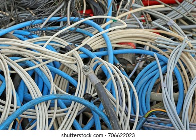 many copper cables with plastic insulation in the dump of polluting and recyclable materials