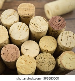 Many corks of different wine bottles, view from above, square