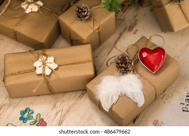 many craft gift boxes on wooden background