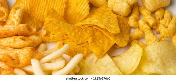 Many Crispy Snacks food potato chip salty. Fast food or junk food snacks unhealthy concept.