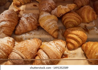 many croissants on a supermarket shelf for sale