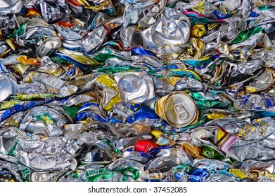 Many crushed soda cans on a scrapyard