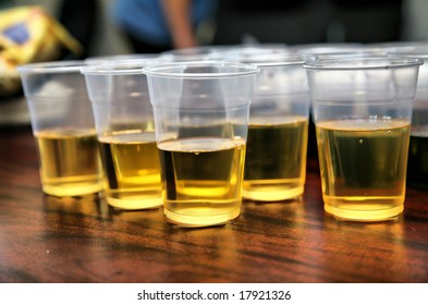 Many Cups of Beer on Wood Grain Table