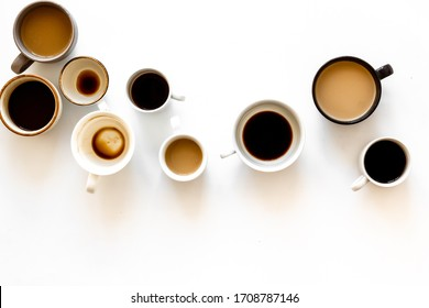 Many cups of coffee on white desk top view space for text