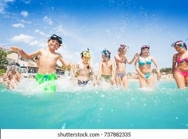 Many cute kids in sea splash fight