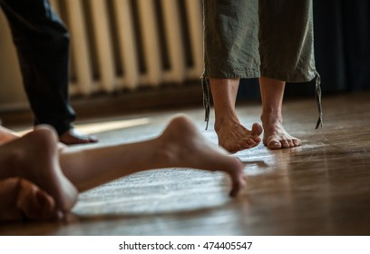 many dancers foots on floor, on blurred background, contact dancer improvise