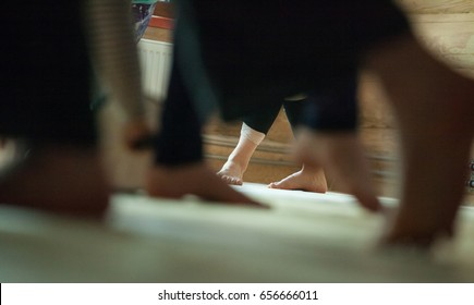 many dancers foots on floor, on blured background