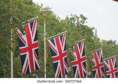 Many defocussed Union Jack flags background with copy space