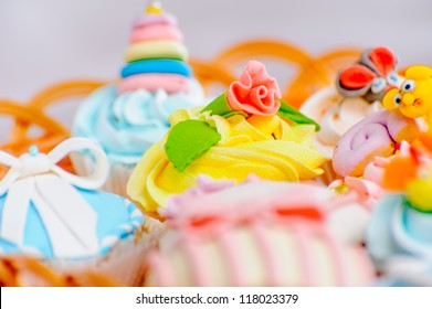 many delicious colorful cupcakes in a basket