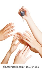 Many desperate hands reaching for car keys