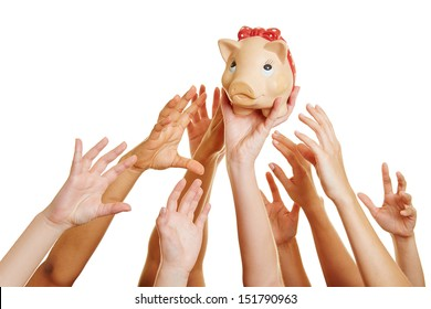 Many desperate hands reaching for money in a piggy bank