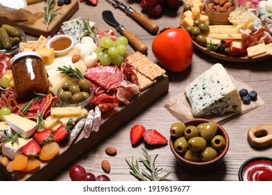 Many different appetizers served on wooden table