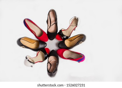 Many different beautiful chic heeled shoes on a white background