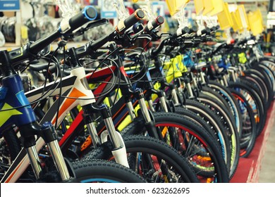 Many different bicycles indoors, closeup