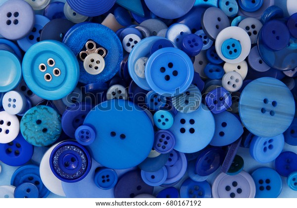 Many different blue buttons close-up. The background.