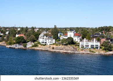 Many different building and houses are on coastline of Stockholm archipelago in Sweden. Joint valley landscape. Scandinavia