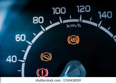 Many different car dashboard lights with warning lamps illuminated.