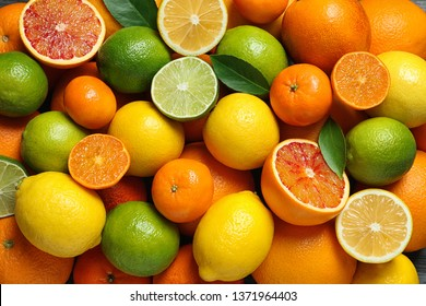 Many different citrus fruits as background, top view