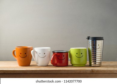 Many different coffee cups on wooden table. Friendship day celebration background