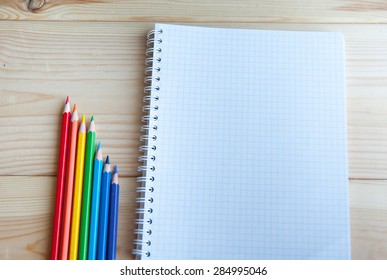 many different colored pencils on paper are