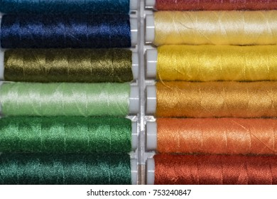 many different colors sewing Thread spools