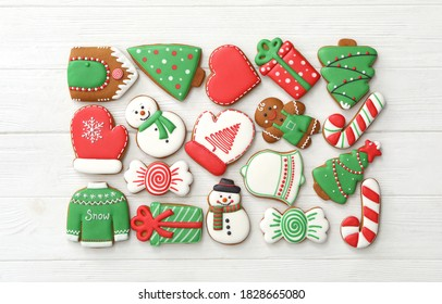 Many different delicious Christmas cookies on white wooden table, flat lay