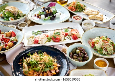Many different delicious dishes dishes on the table. Various snacks and antipasti on the table. Restaurant menu. Italian cuisine