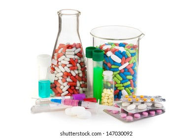 Many different drugs in pills, tablets in packages  and syringe put in laboratory bottles and flasks