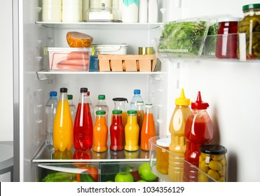 Many different fresh products in modern refrigerator