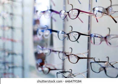 Many different glasses displayed at optician in store