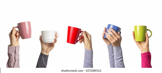 Many different hands holding multi colored cups of coffee on a white background. Female and male hands. Concept of a friendly team, a coffee break, meeting friends, morning in the team. Banner