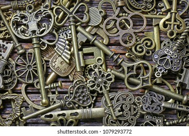 Many different keys on wooden background