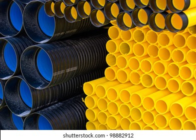 Many different kind of plastic pipes on pile.