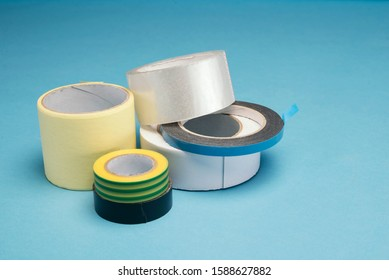 many different kind of scotch tapes on a blue background.