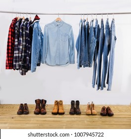 Many different men mens colorful cotton plaid shirts,clothes,jeans shoes  on hangers