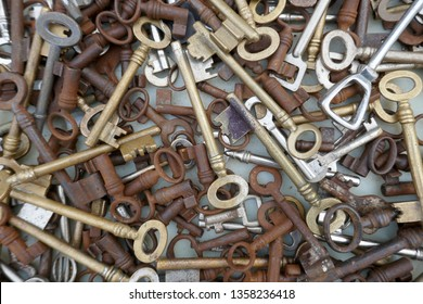 Many different old, rusty keys to sell at the flea market. Close up, background and texture.