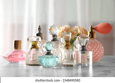 Many different perfume bottles on dressing table