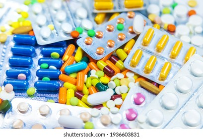 Many different pills and capsules. Selective focus. medicine.