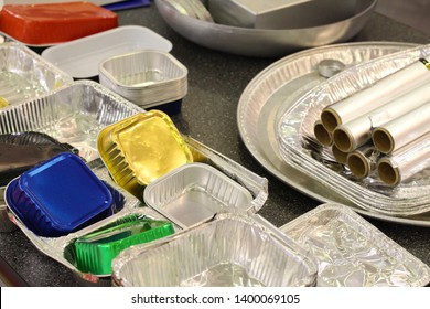 Many different products from aluminum. Aluminum food packaging, Foil. Disposable food containers made of aluminum.