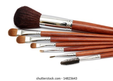 Many different size makeup brush on white background.