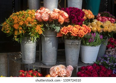 Many different spring flowers in baskets for bouquets on sale in the market